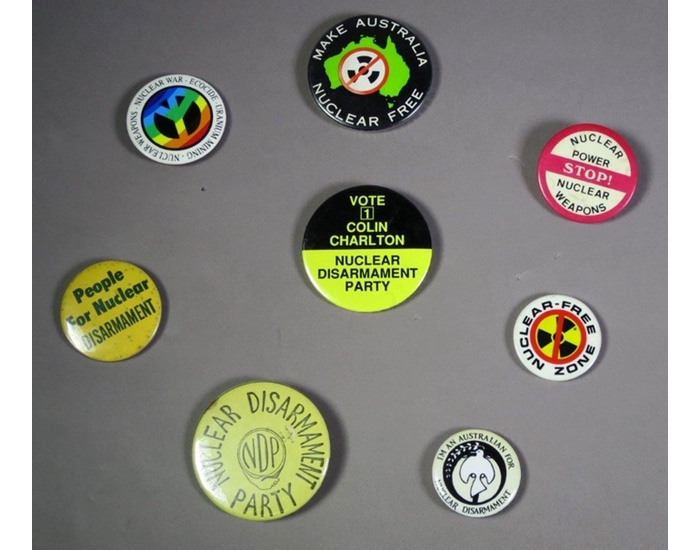 A group of badges for disarmament