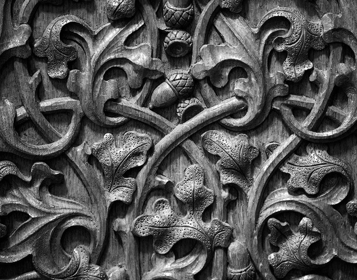 An image showing the detail of the oak-inspired carving in the Speaker's Chair.